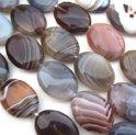 Natuurstenen kralen, Botswana Agaat, plat ovale kralen van 16x12x4mm. Verkocht per streng van ca. 40cm (ca. 26 kralen)